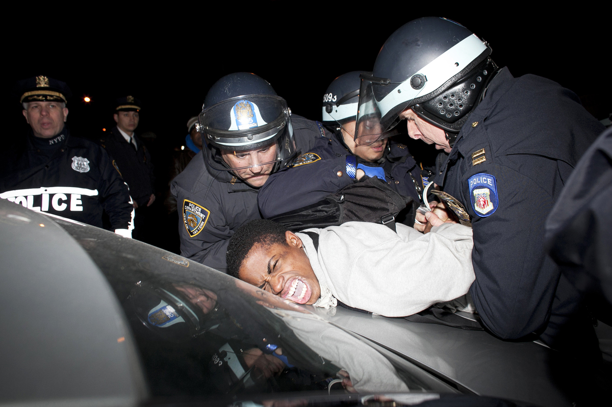 A man is arrested at a protest against the shooting of Kimani Gray, March 13, 2013 in the East Flatbush neighborhood of the B