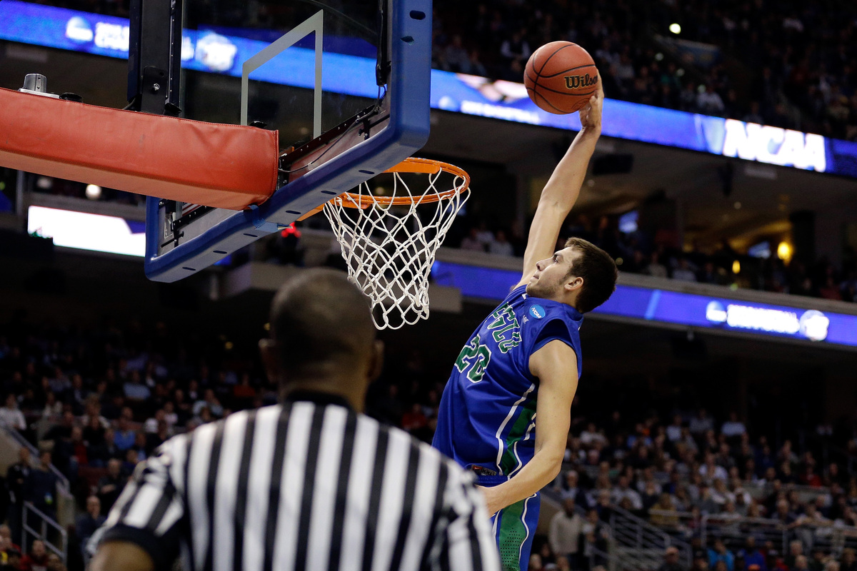 Chase Fieler #20 of the Florida Gulf Coast Eagles dunks in the second half against the Georgetown Hoyas  during the second ro