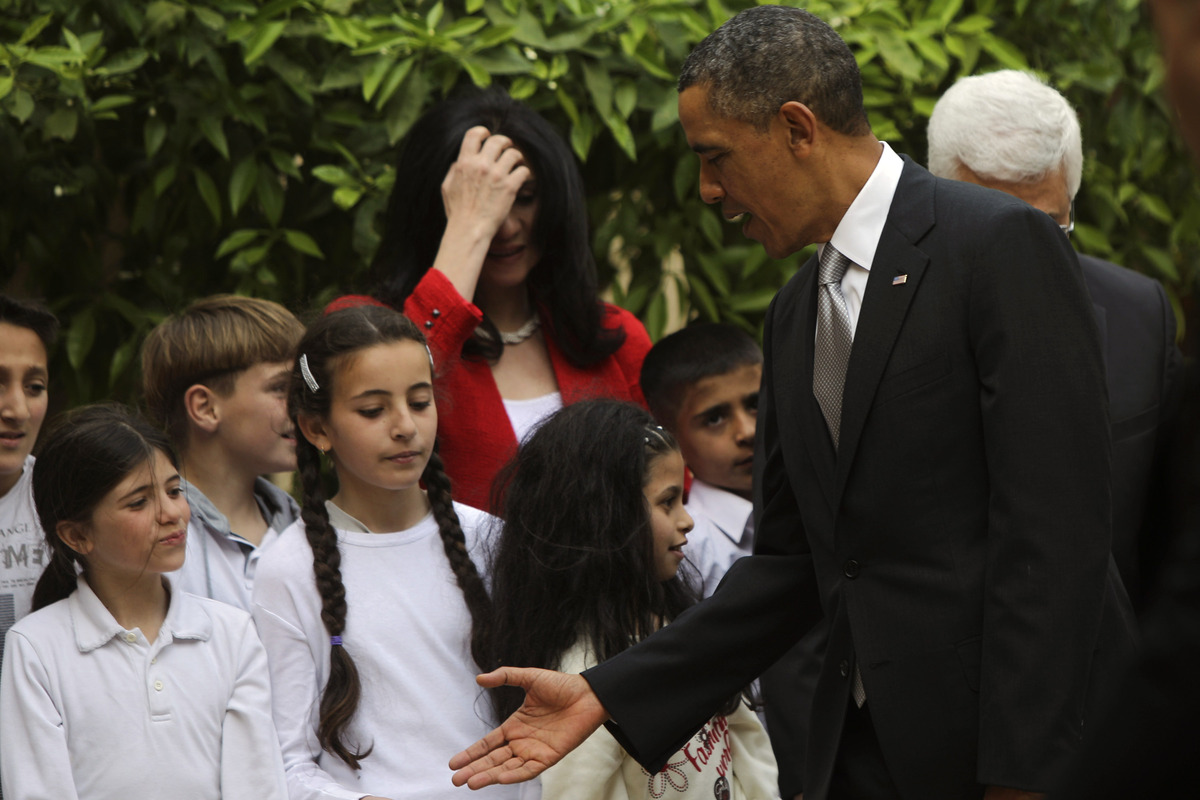 BETHLEHEM, WEST BANK - MARCH 22:  U.S. President Barack Obama shakes hands with Palestinian kids during a visit to the Church