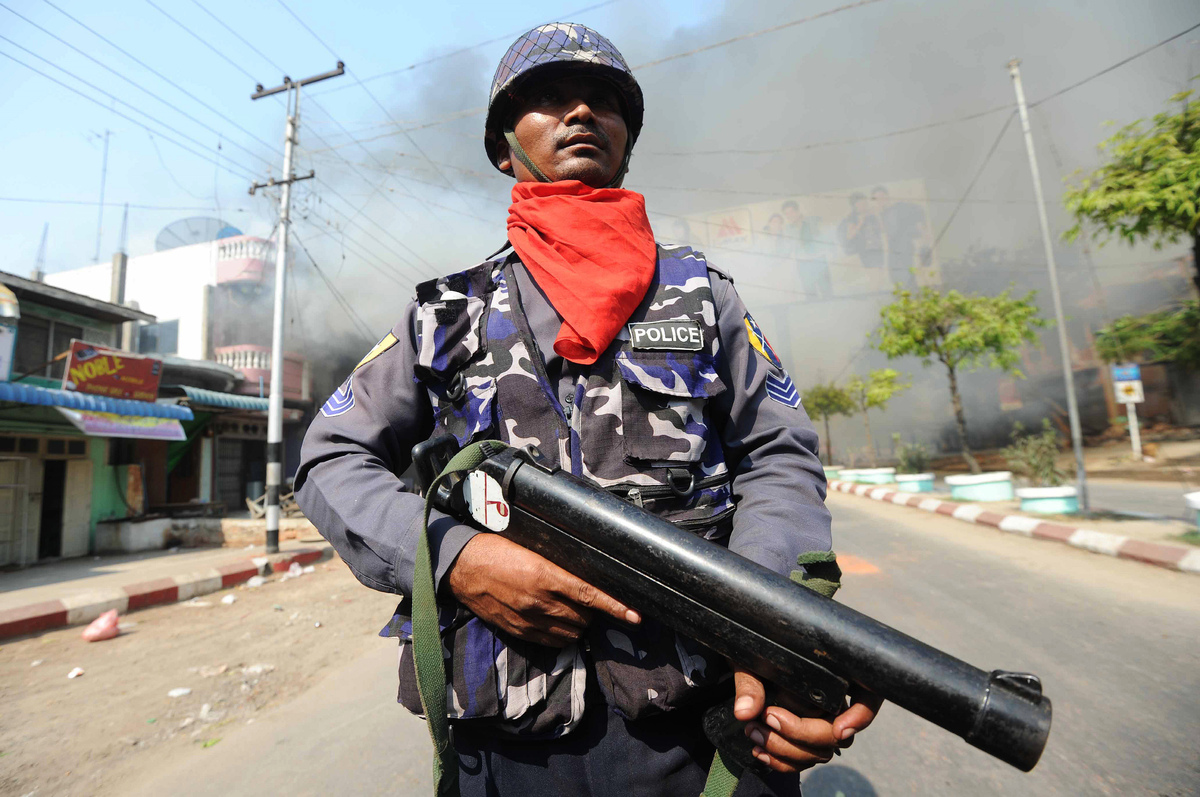 A policeman stands guard in a street in riot-hit Meiktila, central Myanmar on March 22, 2013. Myanmar declared a state of eme