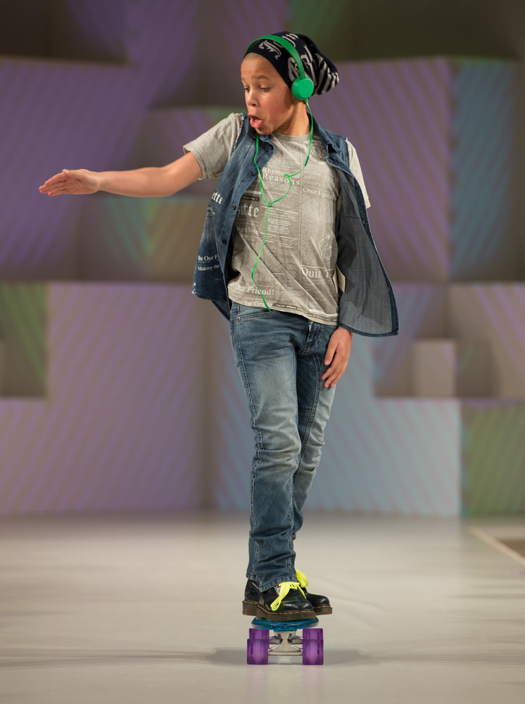 LONDON, ENGLAND - MARCH 20: A model wearing John Galliano Spring/Summer '13 walks the runway at the Global Kids Fashion Week