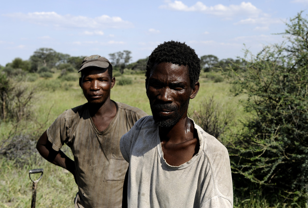 Kalahari Bushmen pose for a photograph on February 19, 2012 in Molapo, in the centre of the Kalahari Game Reserve. (STEPHANE