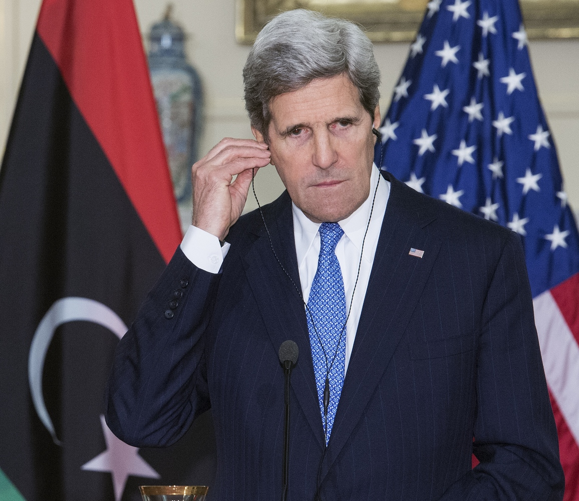 US Secretary of State John Kerry listens on his translation headsets as Libyan Prime Minister Ali Zeidan (not seen), delivers