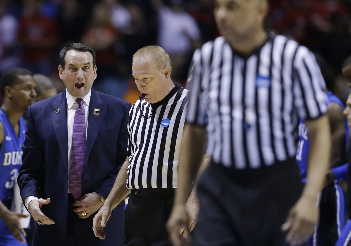 Duke head coach Mike Krzyzewski argues a call with officials during the first half of the Midwest Regional final against Loui