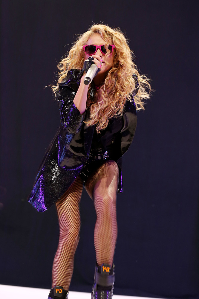 This Thursday, Aug. 9, 2012 photo released by Starpix shows Mexican singer Paulina Rubio performing at the 2012 Zumbathon Fit