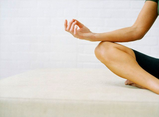 Sit cross-legged on a yoga mat with your hand on your knees, palms up. Keep your spine as straight as you can. Push the bones