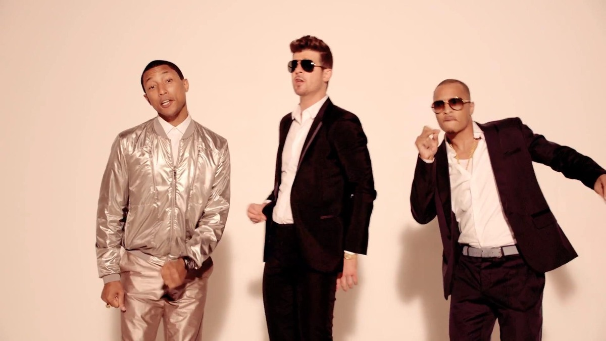 "<a href=""http://www.vevo.com/watch/robin-thicke/blurred-lines/USUV71300454"" target=""_blank"">Blurred Lines</a> - Robin Thicke"