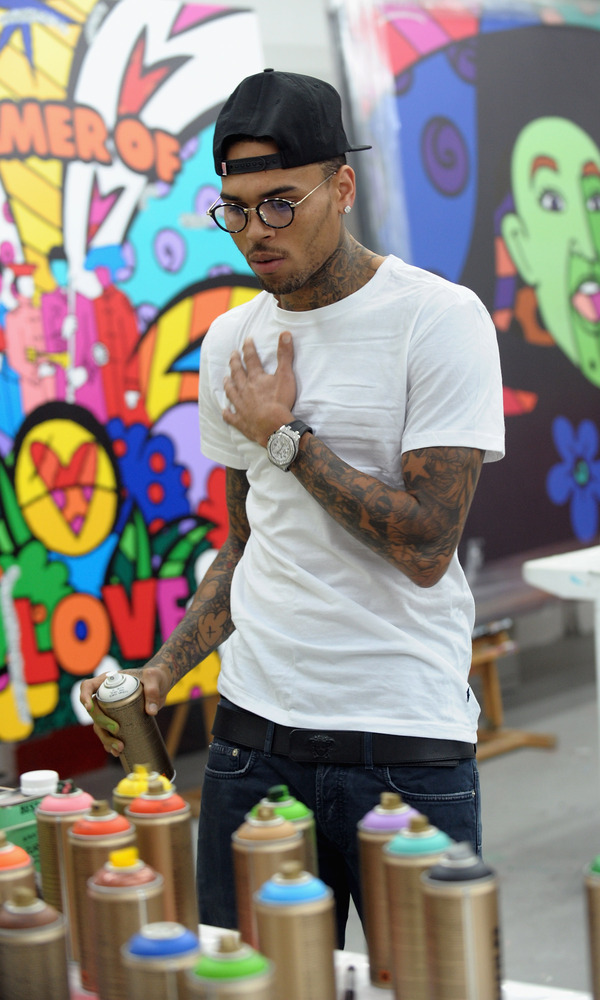 MIAMI, FL - MARCH 27: (EXCLUSIVE ACCESS)   Chris Brown joins forces with artist Romero Britto in support of Best Buddies Inte