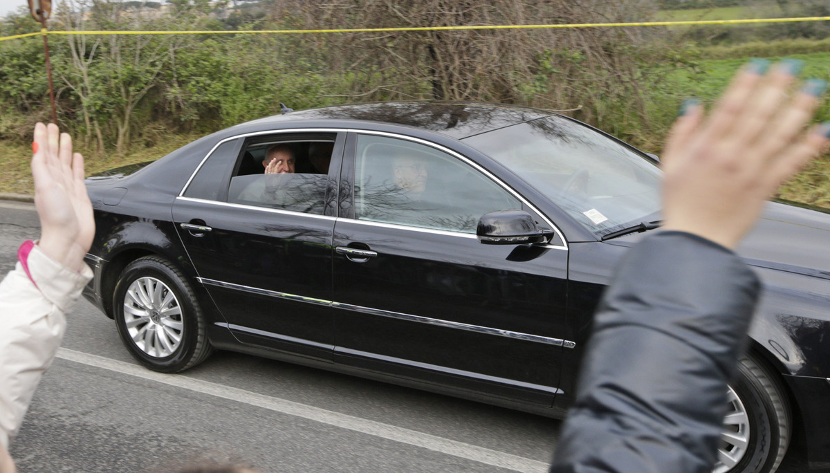 Pope Francis waves from his car as he arrives at the juvenile detention center of Casal del Marmo to celebrate the rite of th