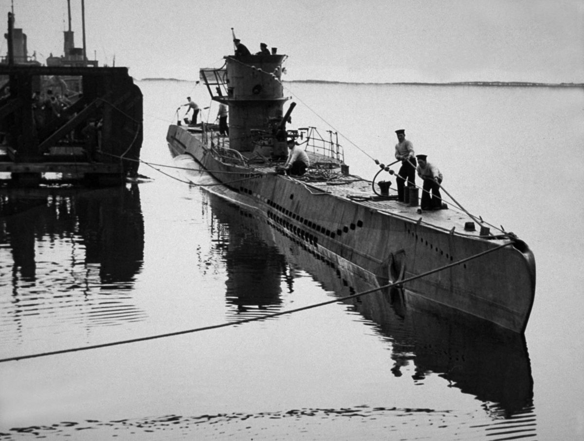Circa 1941: A German U-Boat, which was captured in the Atlantic by a Hudson aircraft of the Coastal Command, being brought in