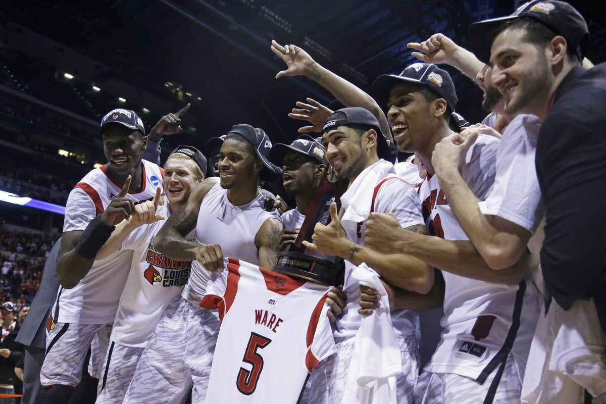 Louisville players celebrate following their 85-63 win over Duke in the Midwest Regional final in the NCAA college basketball