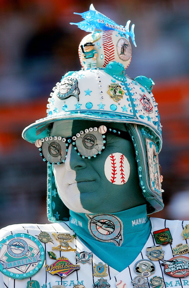 MIAMI - APRIL 5:  A Florida Marlins fan watches as they are introduced before playing the Atlanta Braves at Dolphins Stadium