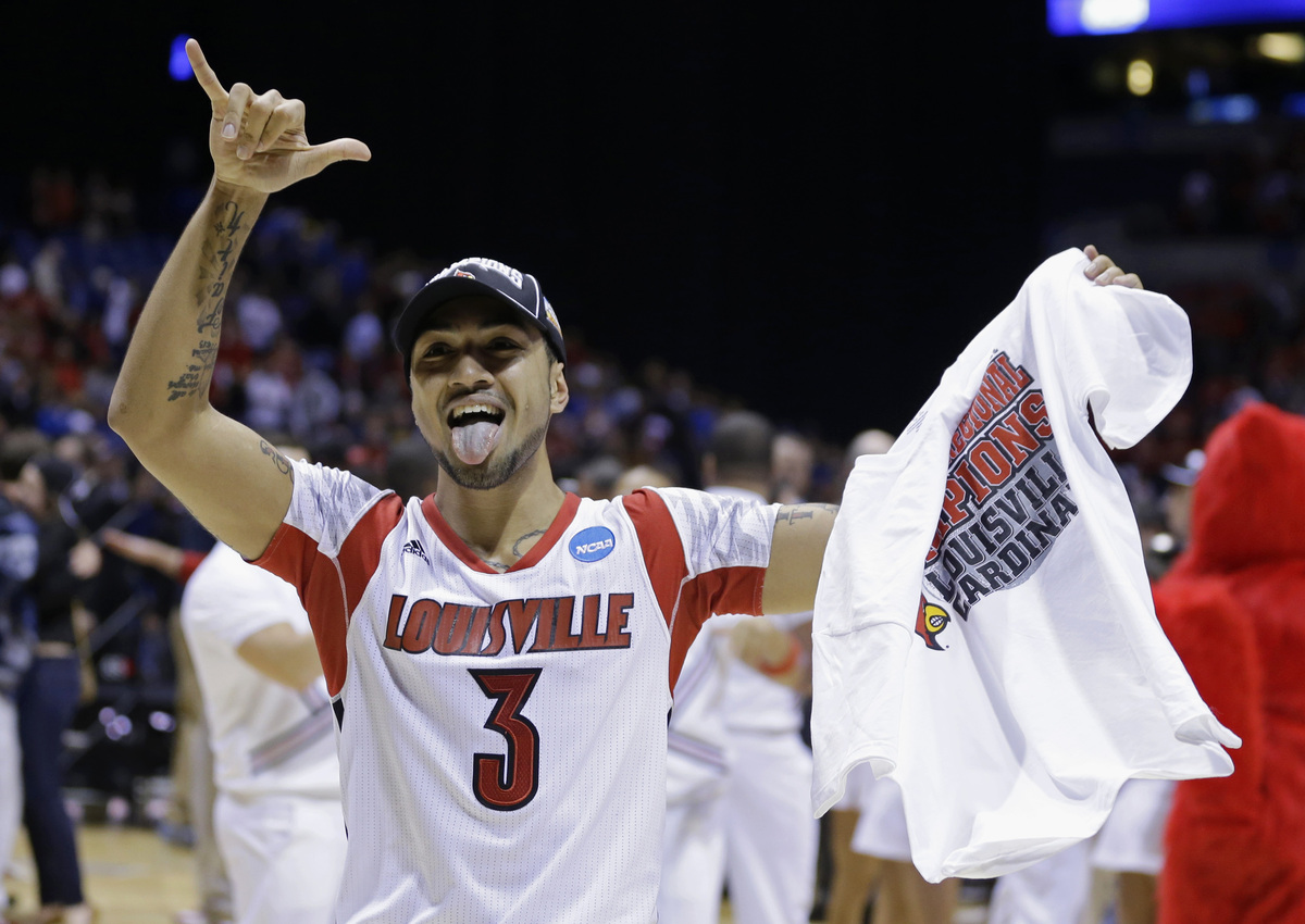 Louisville guard Peyton Siva celebrates after Louisville's 85-63 win over Duke in Midwest Regional final in the NCAA college