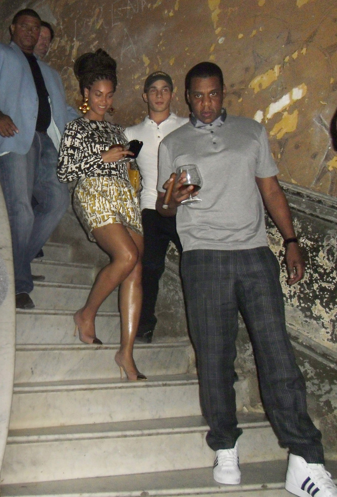 U.S. singer Beyonce, center, and her husband Jay-Z, right, walk down the stairs at La Guarida restaurant in Havana, Cuba, Wed