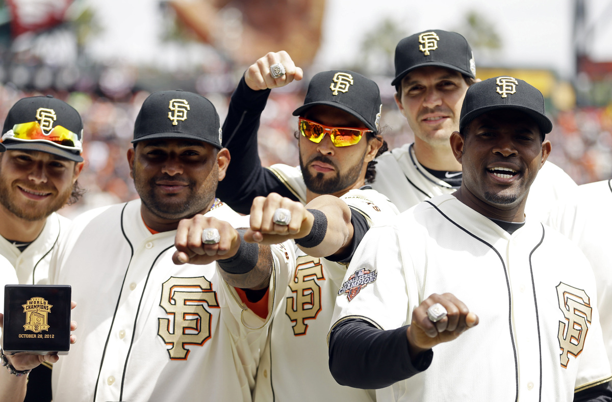 From left, San Francisco Giants' Brandon Crawford, Pablo Sandoval, Angel Pagan, Barry Zito and Santiago Casilla show their 20