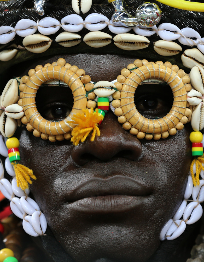A Burkina Faso soccer fan waits for the start of the African Cup of Nations semifinal soccer match at Mbombela Stadium agains