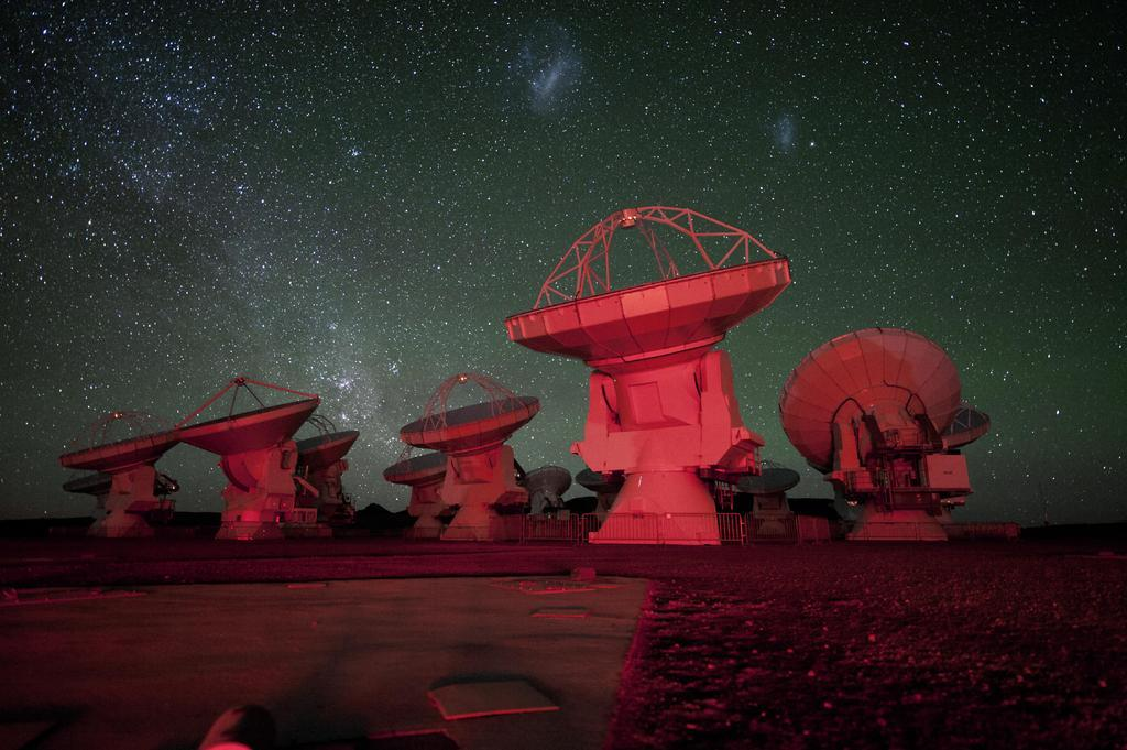 ALMA antennae with the southern Milky Way (left) and the Magellanic Clouds (top) in the background.
