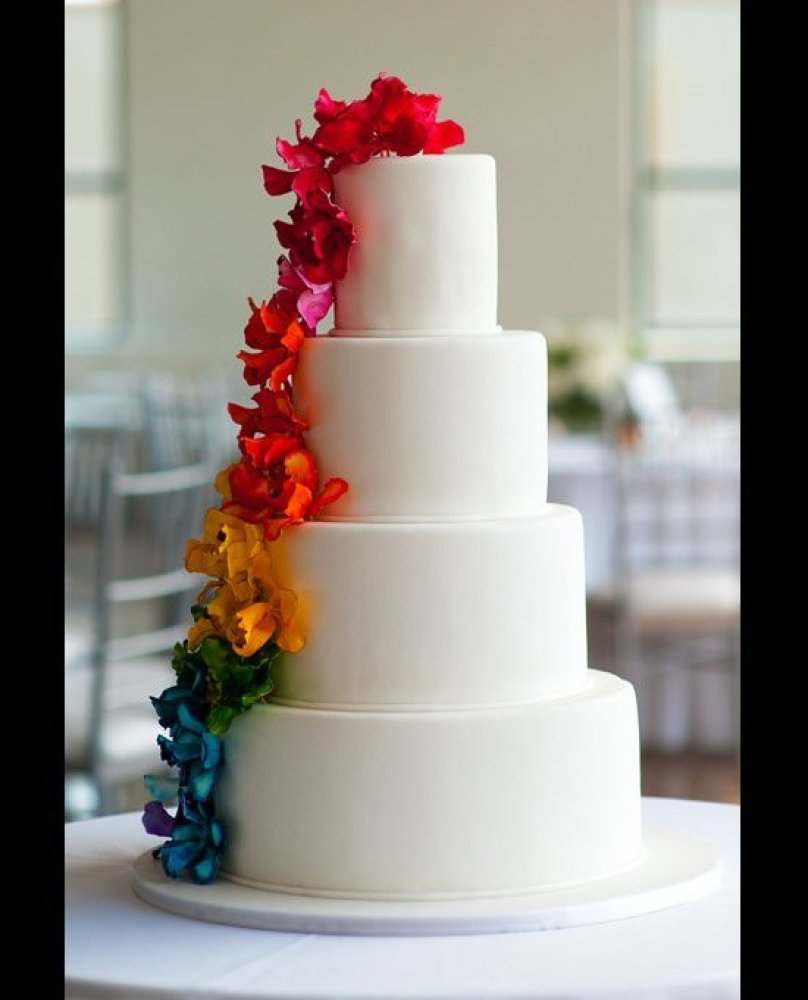 How chic is this rainbow wedding cake? I always love a good rainbow cake, but most of the multicolor designs I've seen are on