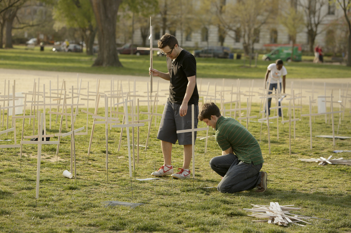 Volunteers set up 3,300 grave markers representing gun violence deaths since Newtown