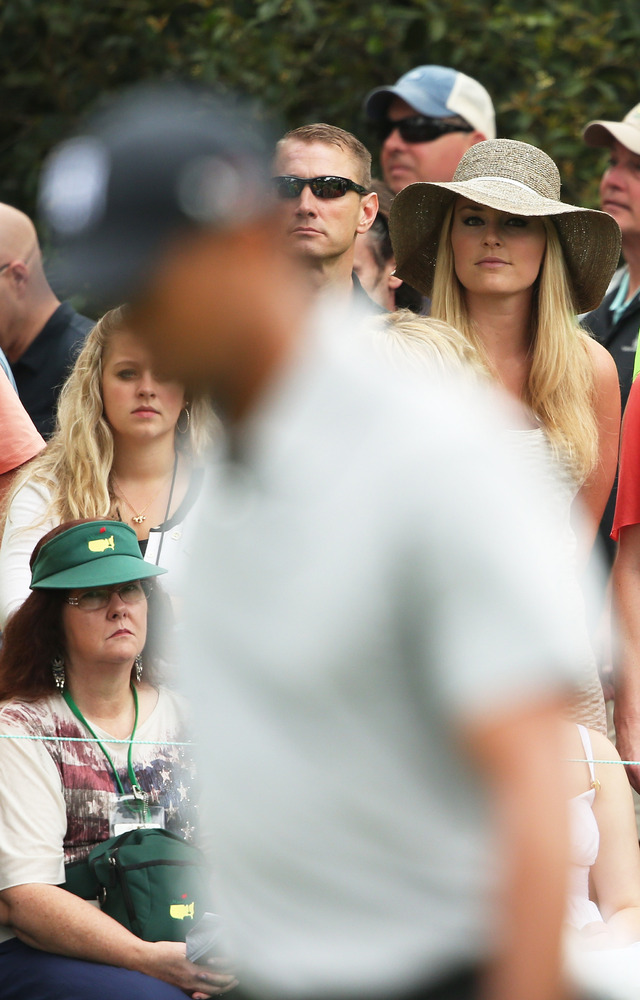 AUGUSTA, GA - APRIL 11:  Skier Lindsey Vonn watches as boyfriend Tiger Woods of the United States plays the first hole during