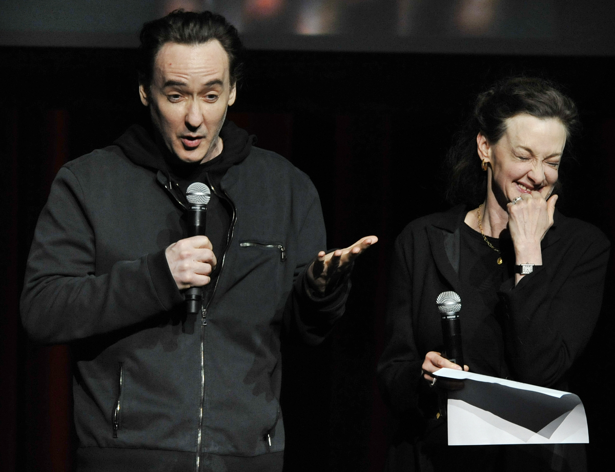 Actors John Cusack left, and Joan Cusack right, talk about Roger Ebert during a memorial for the film critic at The Chicago T