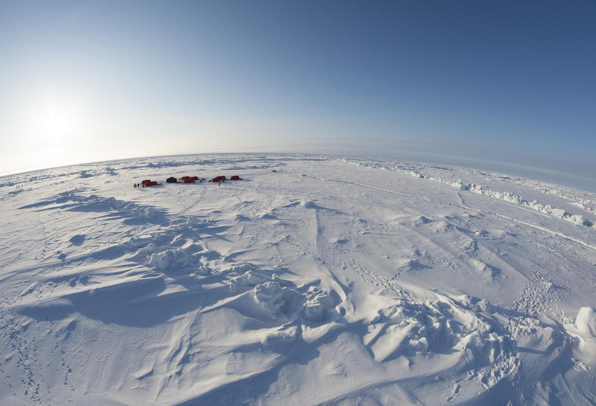 A Greenpeace encampment at the North Pole, shortly after the team's arrival. The Greenpeace team has brought a time capsule c
