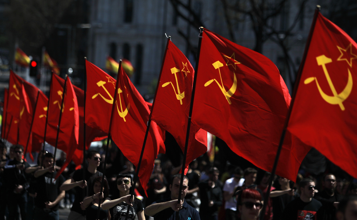 Protestors carry communist flags during a protest against the monarchy in Madrid, Spain, Sunday, April 14, 2013. (AP Photo/An