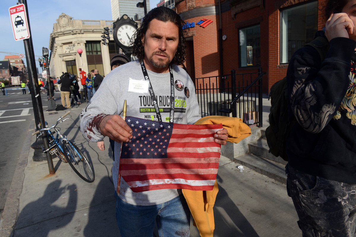 Carlos Arredondo, who was at the finish line of the 117th Boston Marathon when two explosives detonated, leaves the scene on
