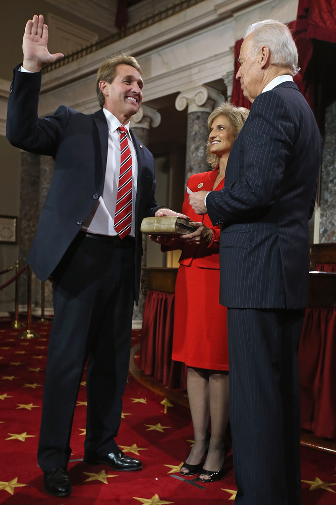 U.S. Sen. Jeff Flake (R-AZ) (L) participates in a reenacted swearing-in with his wife Cheryl Flake (C) and U.S. Vice Presiden
