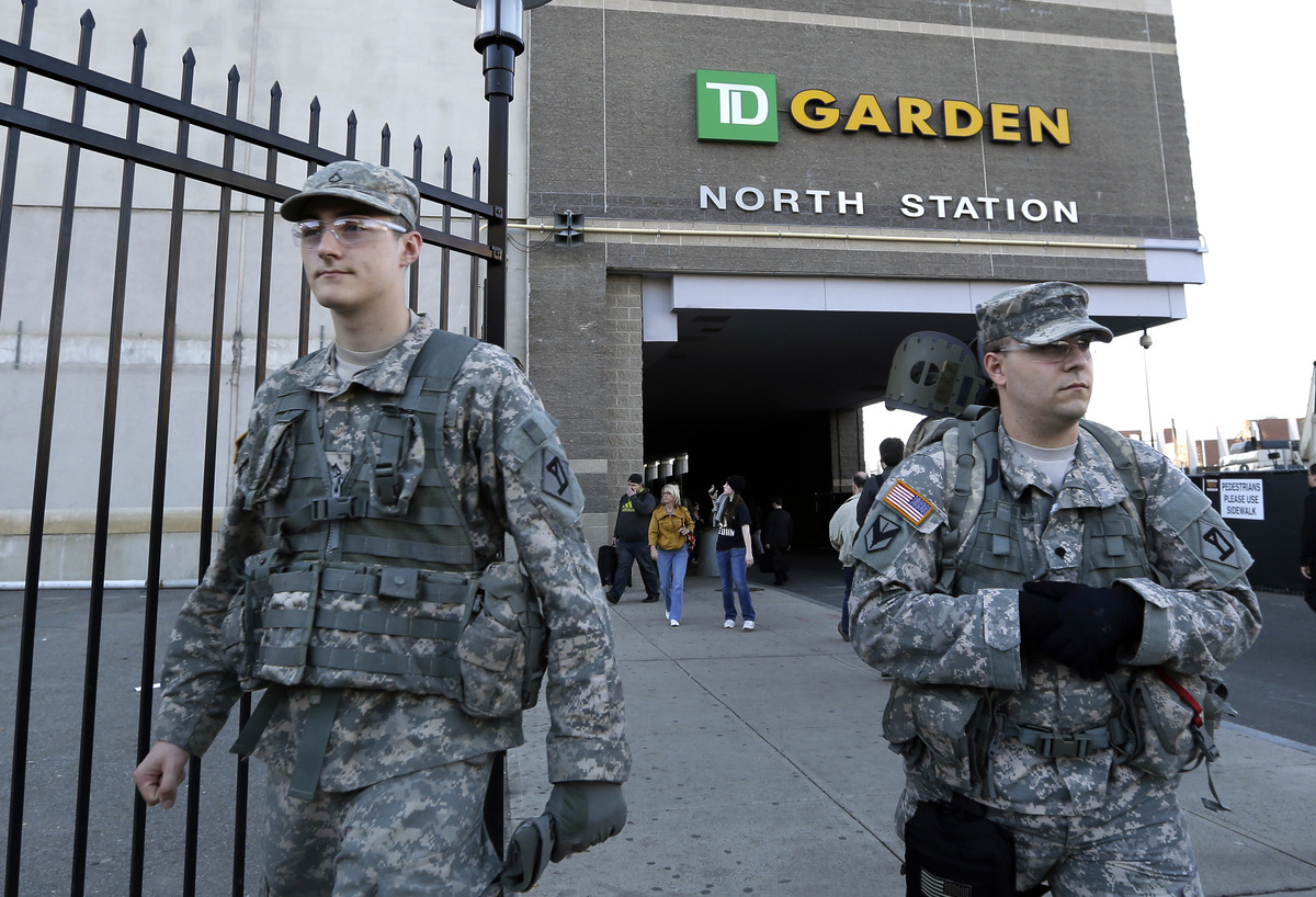 United States soldiers walk outside TD Garden before a Boston Bruins hockey game against the Buffalo Sabres in Boston, Wednes
