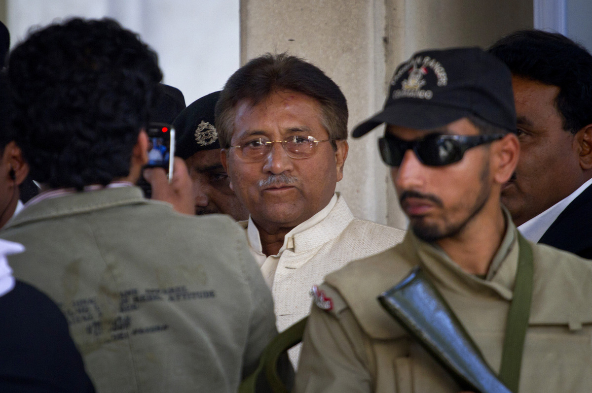 Pakistan's former president and military ruler Pervez Musharraf, center, leaves after appearing in court in Rawalpindi, Pakis