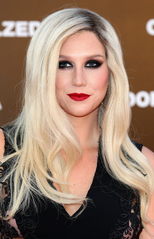 Something has been happening with Ke$ha's style lately. All of a sudden, she's toning it down on the red carpet and we applau