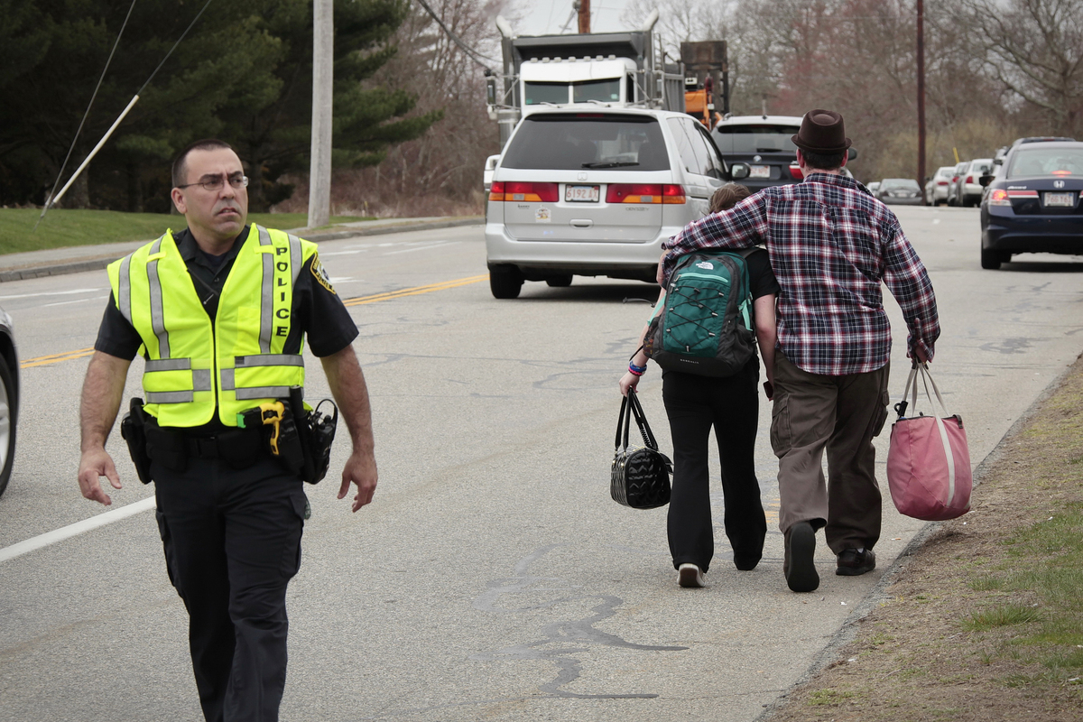 UMASS-Dartmouth students are evacuated from campus on Friday, April 19, 2013 as local and state officials investigate the dor