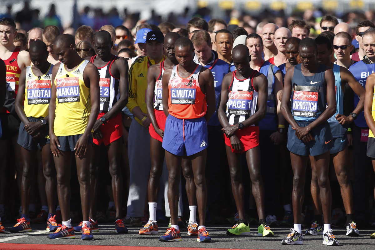 Runners observe a 30 second silent in memory of Boston Marathon bombings before the start during the London Marathon, London,