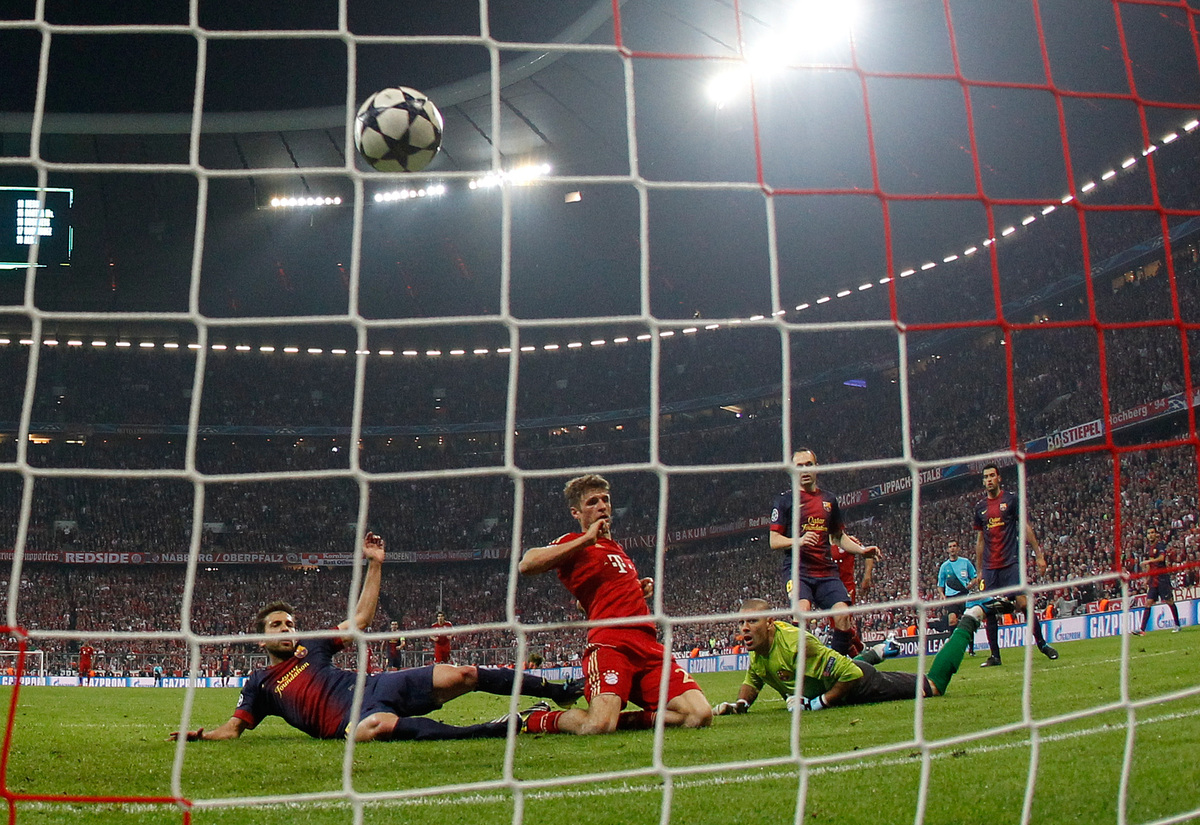 Bayern's Thomas Muller, 2nd left, scores their fourth goal during the Champions League semifinal first leg soccer match betwe