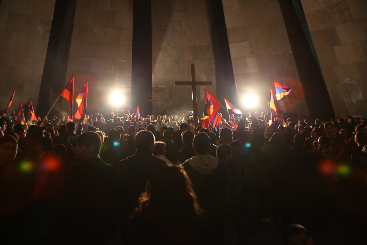 Armenians gather at the monument to the victims of mass killings by Ottoman Turks, in Yerevan, Armenia, Tuesday, April 23, 20