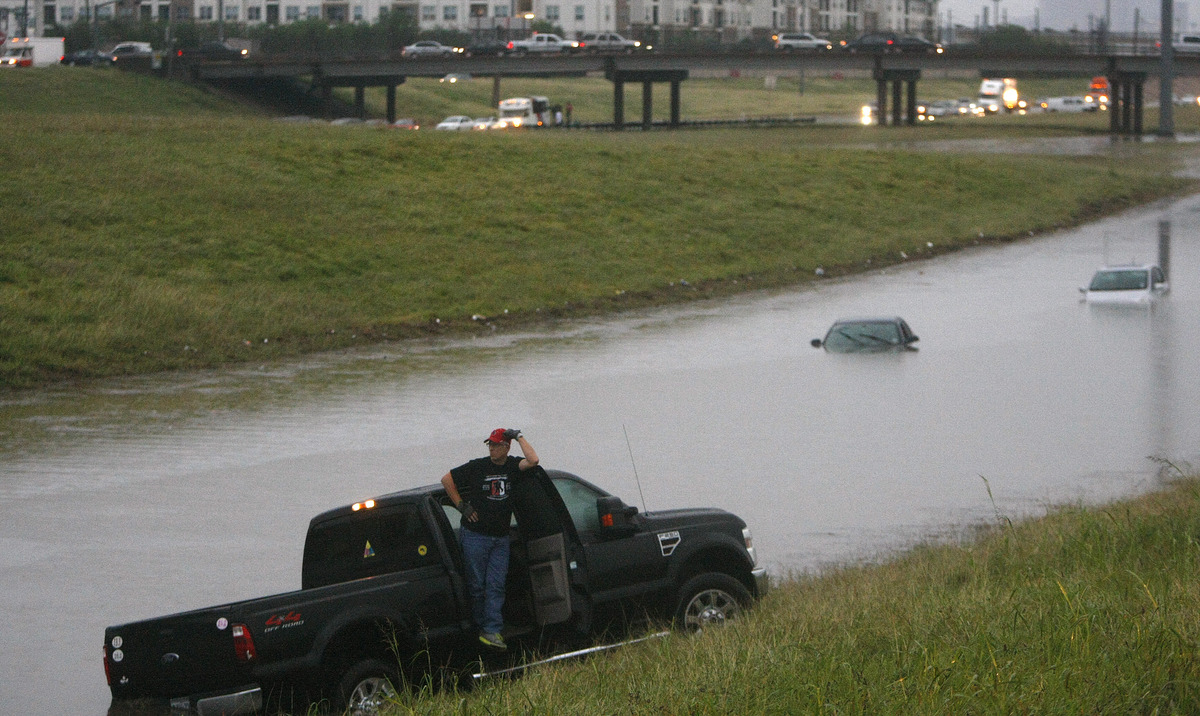 Mike Sobota and his wife Patti, are stranded on 288 at the 610 loop, which became flooded after an afternoon downpour in Sout