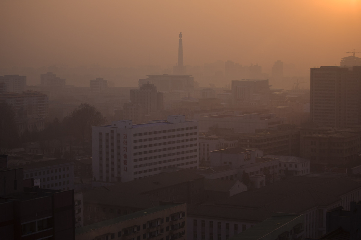 In this April 22, 2013 photo, the sun rises over Juche Tower in Pyongyang, North Korea. (AP Photo/David Guttenfelder)