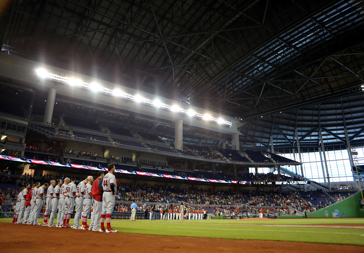 MIAMI, FL - JUNE 16: The St. Louis Cardinals stand for the national anthem against the Miami Marlins at Marlins Park on June