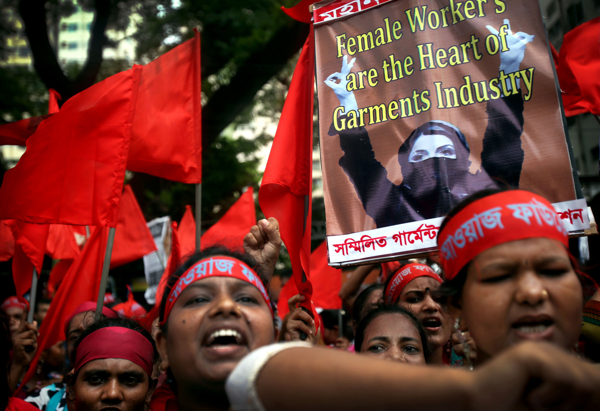 Protestors shout slogans calling for better working conditions for garment workers during a May Day rally on Wednesday, May 1
