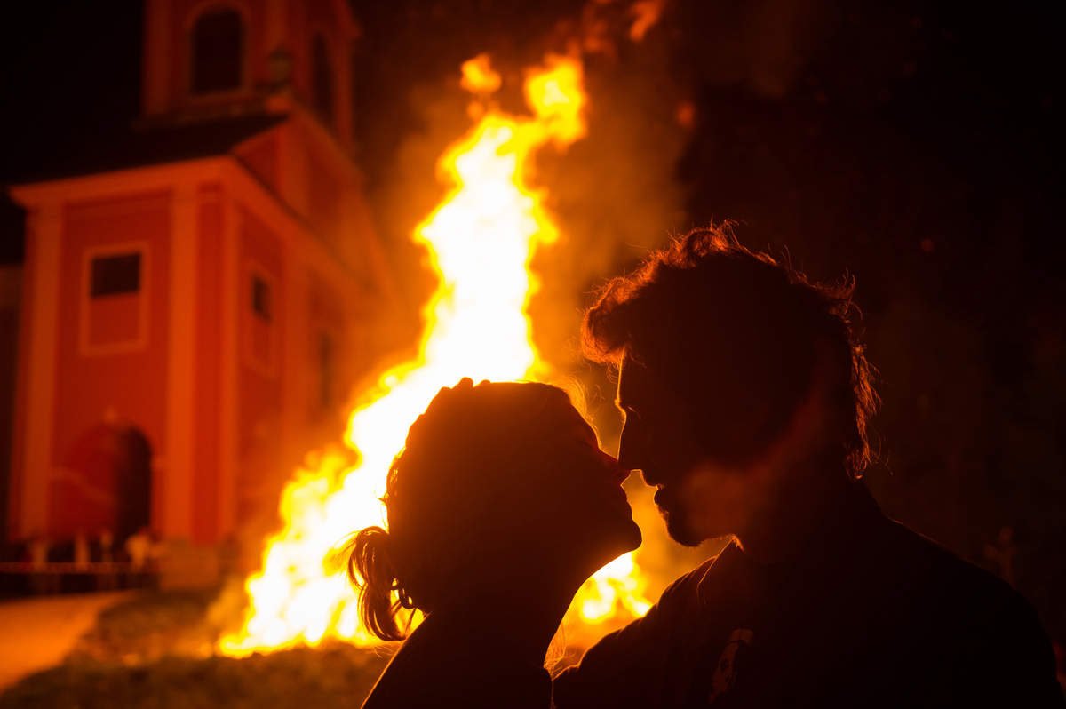 A woman and a man kiss each other in front of the bonfire during the Labour Day celebrations in Ljubljana, on April 30, 2013.