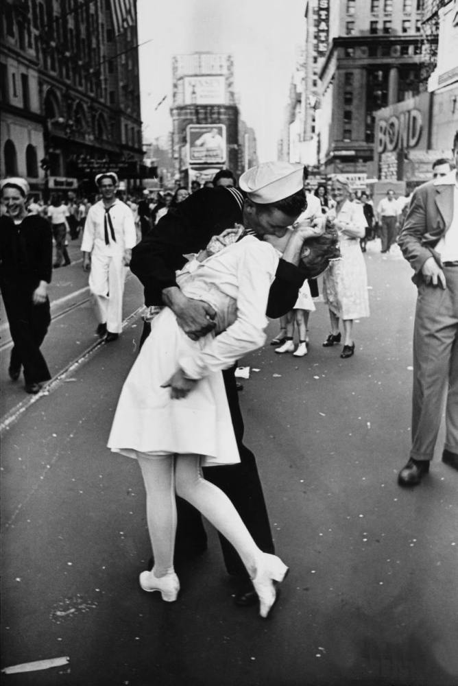 "The 1945 issue of Life that published this Alfred Eisenstaedt photo read: ""In New York's Times Square a white-clad girl clutc"