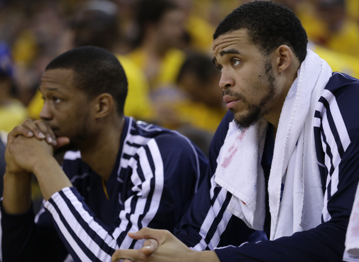 Denver Nuggets' Anthony Randolph, left, and JaVale McGee watch from the bench during the second half of Game 6 in a first-rou