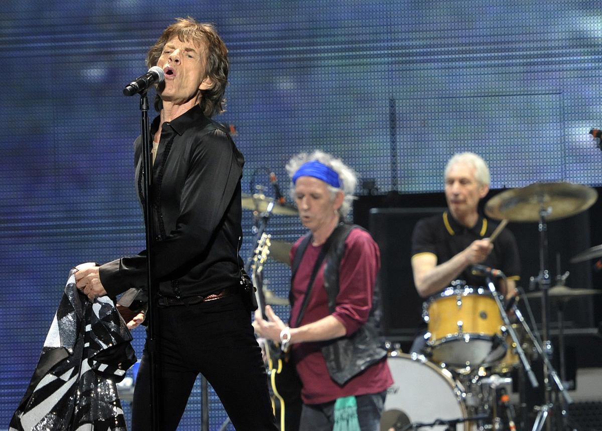 "Mick Jagger, left, Keith Richards, center, and Charlie Watts of the Rolling Stones perform on the kick-off of the band's ""50"