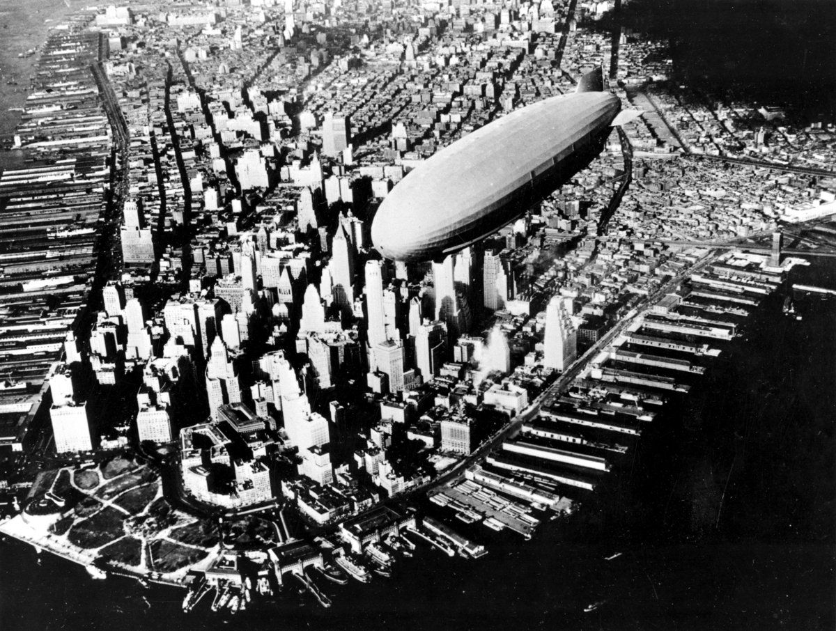 FILE - In this Nov. 2, 1931 file photograph, the USS Navy Air Cruiser Akron flies over lower Manhattan's financial district i