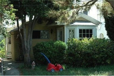 This is the photo from the original MLS listing. The property is two houses on one lot, and this is the house my wife and I d