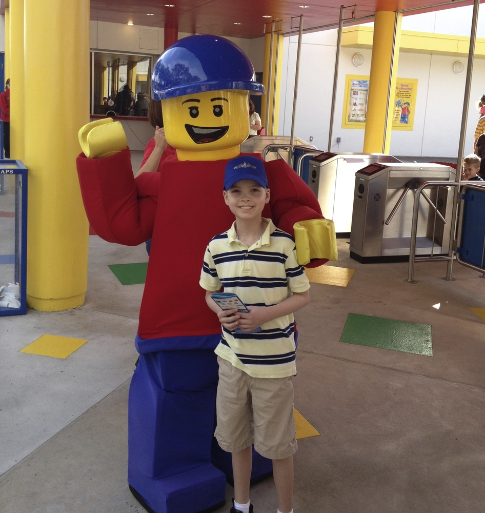 Owen with Legoland's mascot 'Buddy'