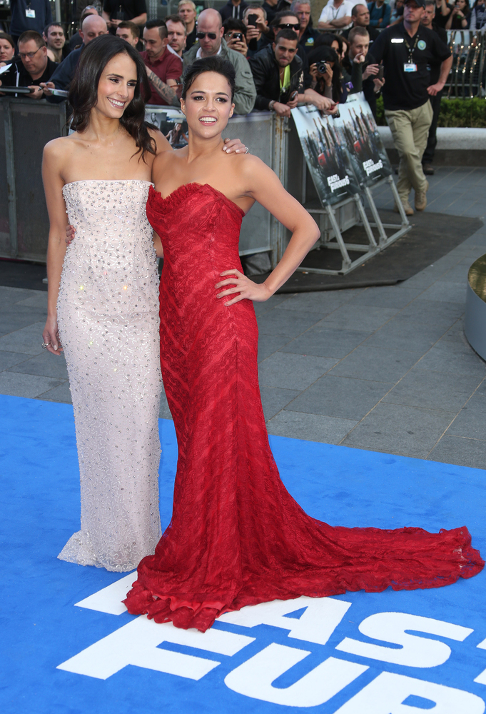 Actresses Jordana Brewster, left, and Michelle Rodriquez arrive for the World Premiere of Fast & Furious 6, at a central Lond