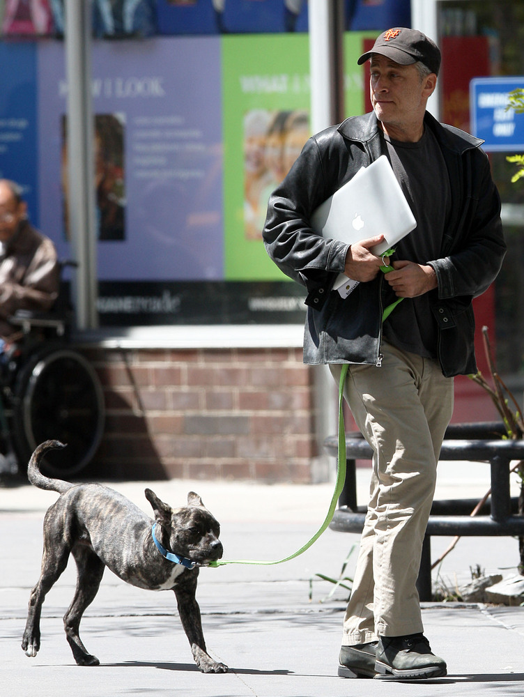 """Jon Stewart of """"The Daily Show"""" is seen taking his three-legged dog, Champ, for a walk in New York, New York on May 5, 2013."""