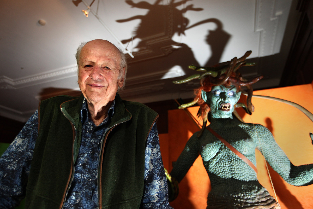 LONDON, ENGLAND - JUNE 29:  Special effects creator Ray Harryhausen poses for photographs with an enlarged model of Medusa fr